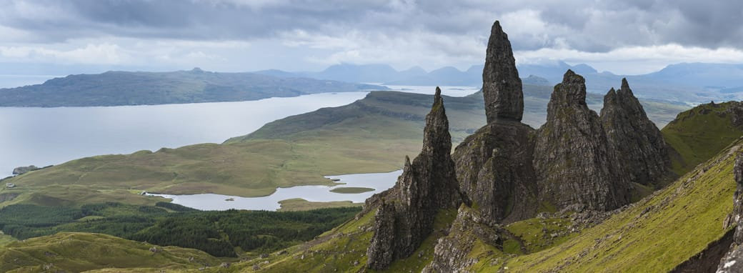 The Old Man of Storr on the Trotternish Peninsula overlooks Loch Leathan on the Isle of Skye