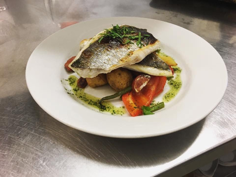 Grilled cod served with baby potatoes, carrots and peppers from the Claymore Restaurant