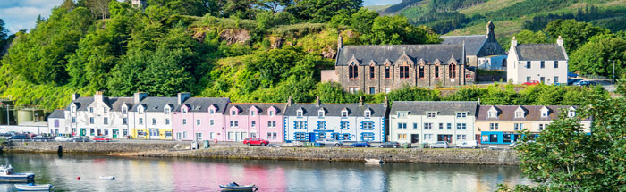 Pastel painted buildings surround Portree Harbour, Isle of Skye