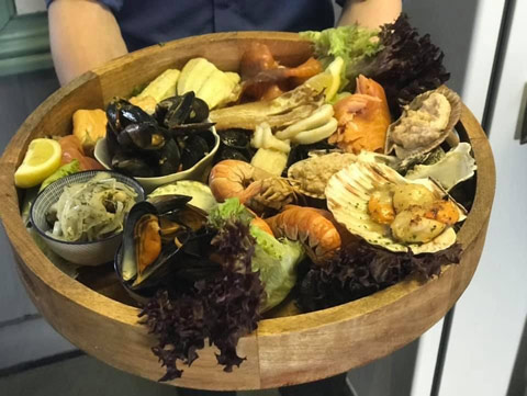 Wholesome Seafood Platter served in a wooden bowl