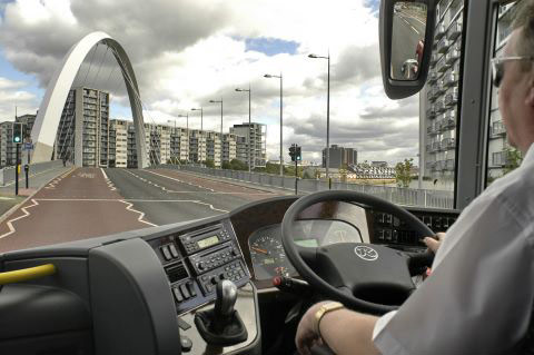 Coach driver makes his way across the Clyde Arc Bridge in Glasgow