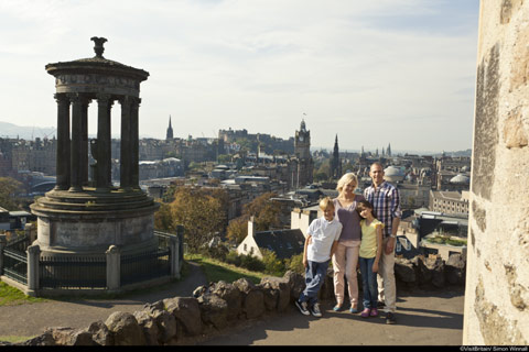 Family pose at Carlton Hillwith Edinburgh Castle and Princes Street in the background