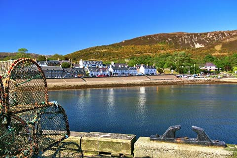 Attractive white-washed buildings line the harbour at Ullapool