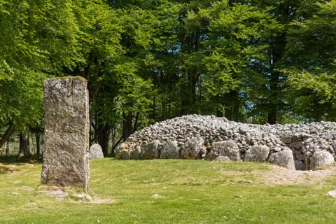 A standing stone guides visitors to the entrance to the Clava Cairns