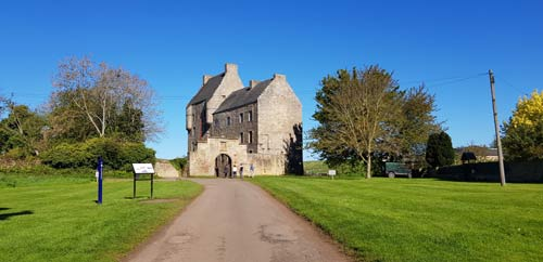 The road leads to the archway of Midhope Castle which features as Lallybroch in the TV series