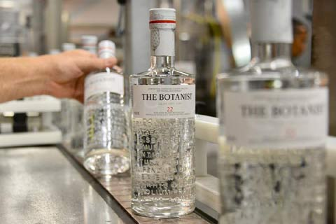 Bottles of Botanist Gin come off the production line at the distillery