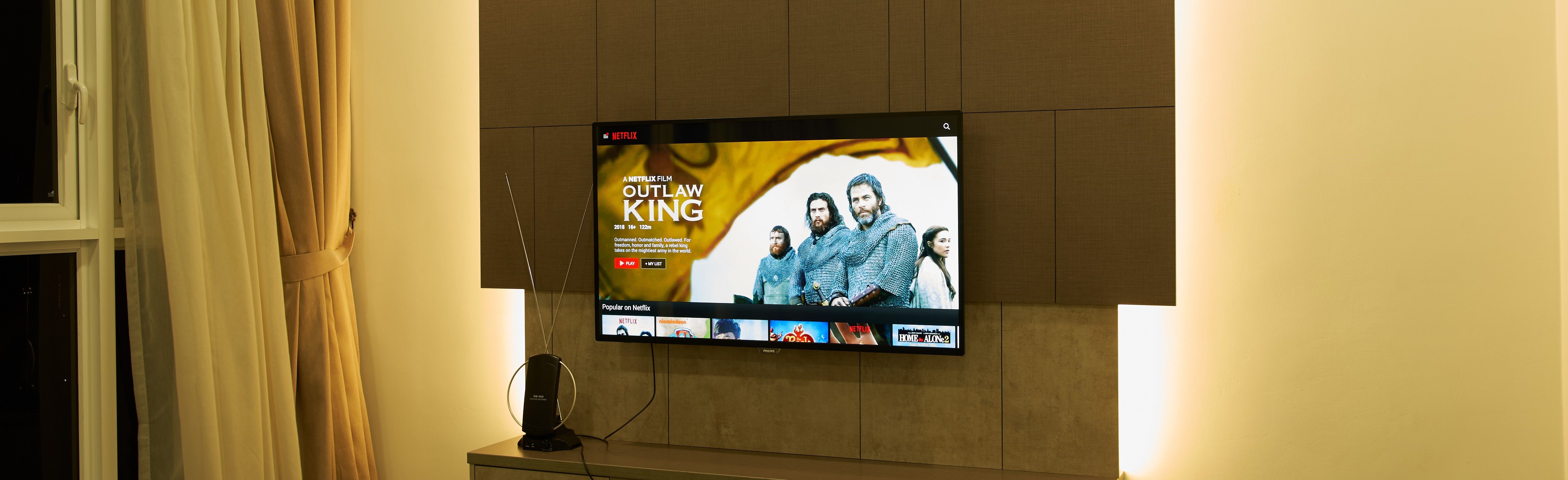 Television showing a trailer for The Outlaw King