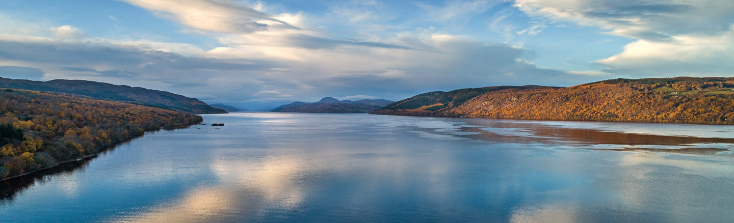 Bright panoramic view of the calm waters of Loch Ness