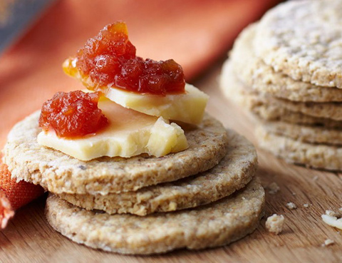 Stack of oatcakes with cheese and chutney