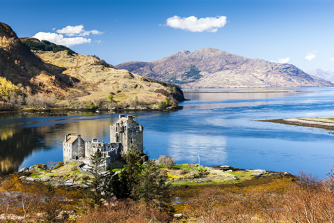 Looking down on Eilean Donan Castle sitting on a little island with the mountains on Kintail in the background