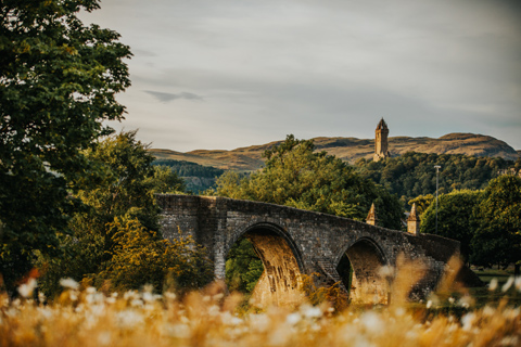 Stirling Bridge which straddles the River Forth overlooked by the Wallace Monument on Abbey Crag