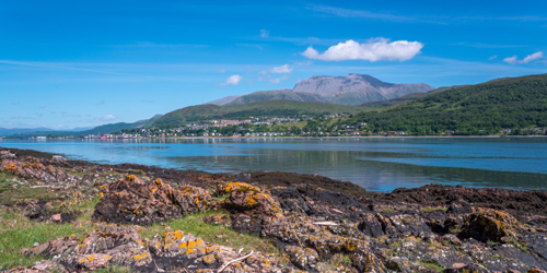 Fort William and and towering Ben Nevis seen from the opposite shore of Loch Linnhe