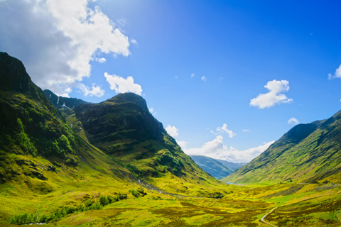 The Three Sisters of Glen Coe mountain range seen on a summer day with blue skies