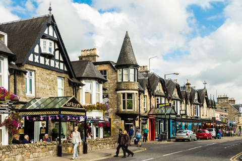 Visitors browse the gift shops on Pitlochry High Street