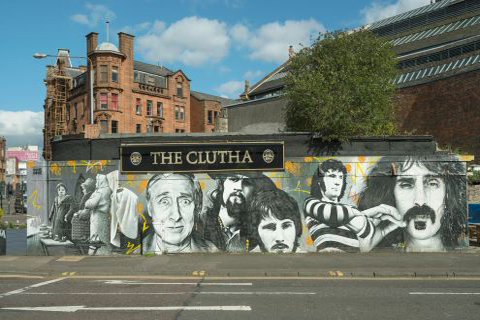 Mural painted on the walls of the Clutha Bar showing famous Glaswegians