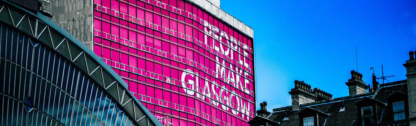 Office block in Glasgow City Centre showing the pink People Make Glasgow logo