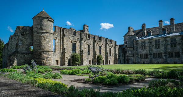 The ruins of Falkland Palace and attractive gardens on a summer day