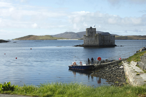 Two visitors board a boat to visit Kismul Castle which sits in the waters of Castlebay