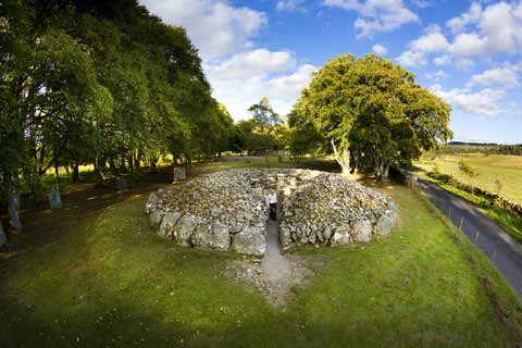 Circular burial chamber at Clava Cairns surrounded by trees