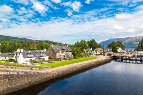 Cottages sitting by the banks of the Caledonian Canal in Fort Augustus