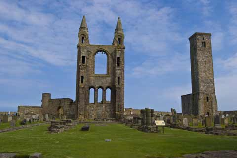 The ruins of St Andrews Castle and St Rule Tower against a bright blue sky