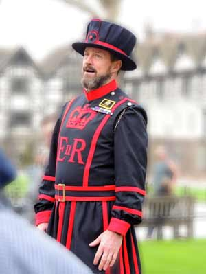 A beefeater dressed in their traditional uniform