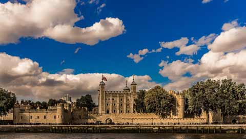 The spawling Tower of London seen from the River Thames