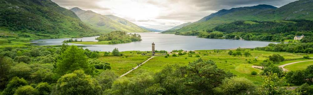 Panoramic view of the Glenfinnan Monument standing by the banks of Loch Shiel