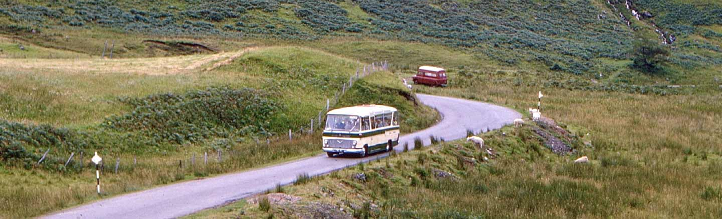 Scottish Omnibuses coach touring through the Scottish Highlands in the 1960s