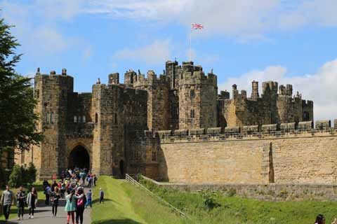 Visitors make their way to enter Alnwick Castle through the Portcullis Gate
