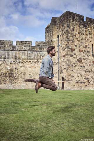 Man rides a broomstick at Alnwick Castle