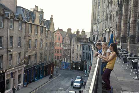 Three friends look down on Victoria Street