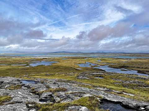 Lochans and moorland stretch into the distance on the Isle of Benbecula