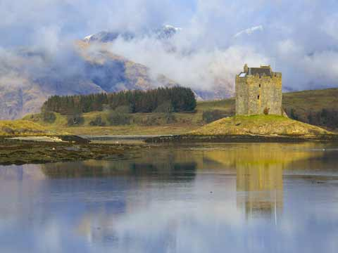Castle Stalker reflected in the waters of Loch Laich