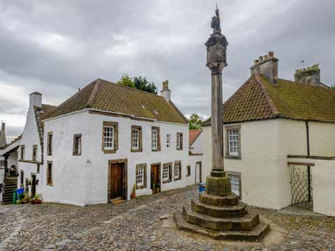 Ther Mercat Cross seen in the centre of Culross