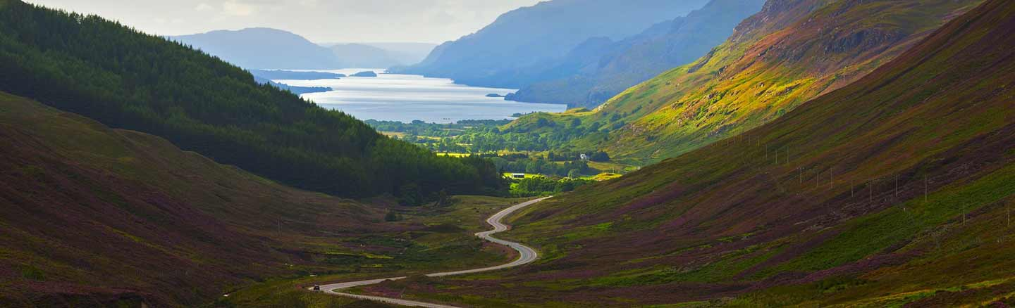 Scenic road from Kinlochewe through Glen Docherty with Loch Maree in the background