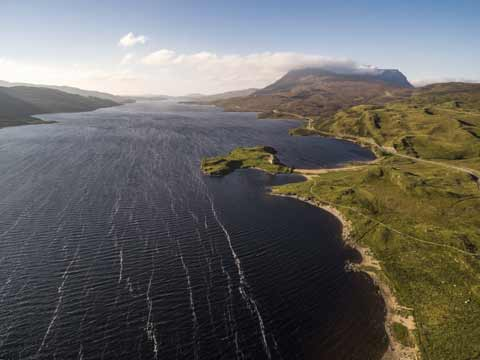Looking down on Loch Assynt and Ardvreck Castle