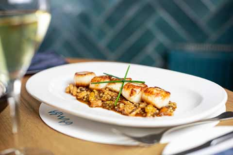 Seared King Scallops served with smoked chicken and puy lentils from Gamba Restaurant