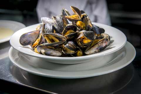 A steaming plate of mussels served at Ee-Urk Restaurant in Oban