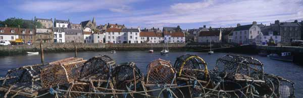 Lobster pots stacked by the harbour at St Monans