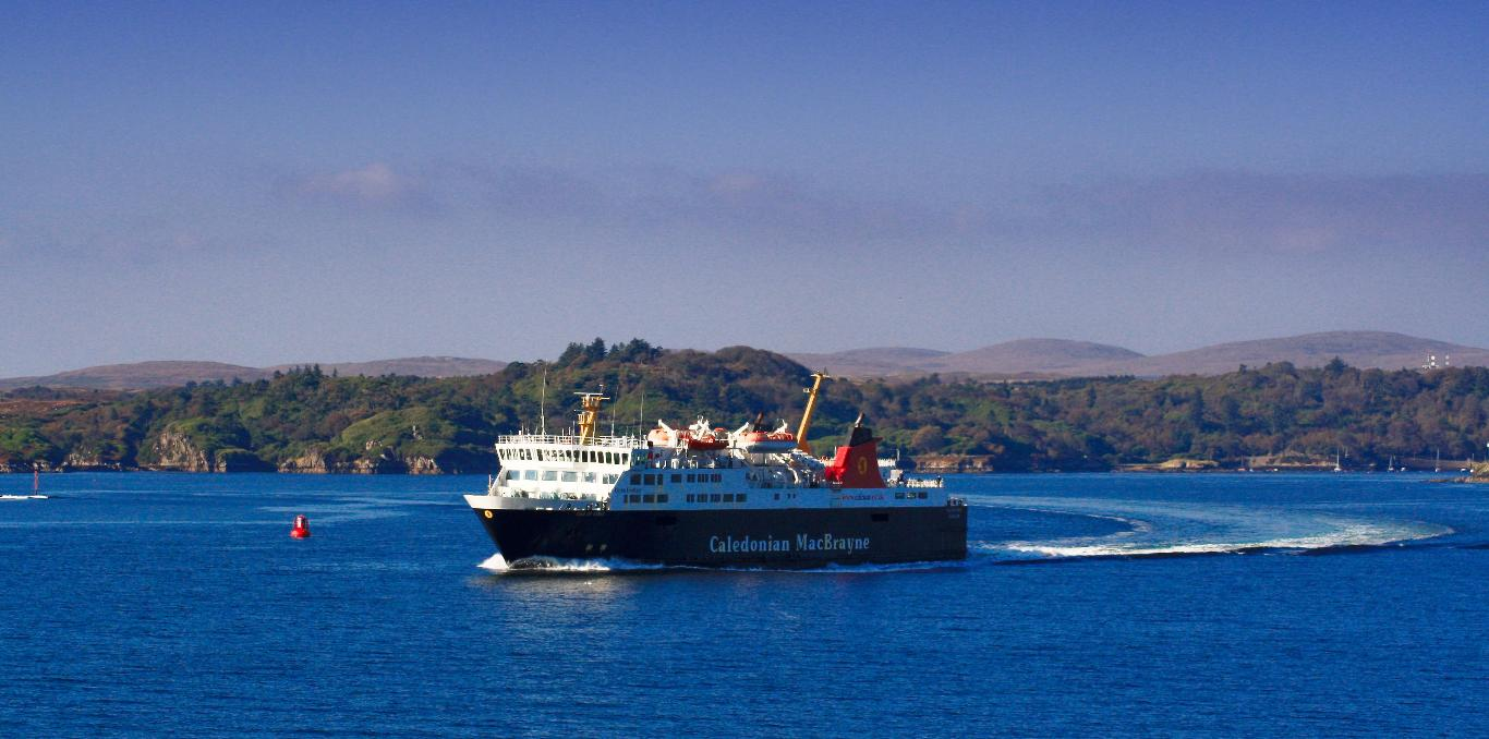 Caledonian MacBrayne ferry Isle of Mull sailing across the bright blue water of Craignure Bay heading to Oban