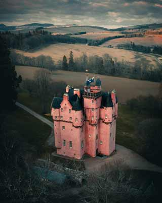 The pink walls of Craigvievar Castle viewed from above