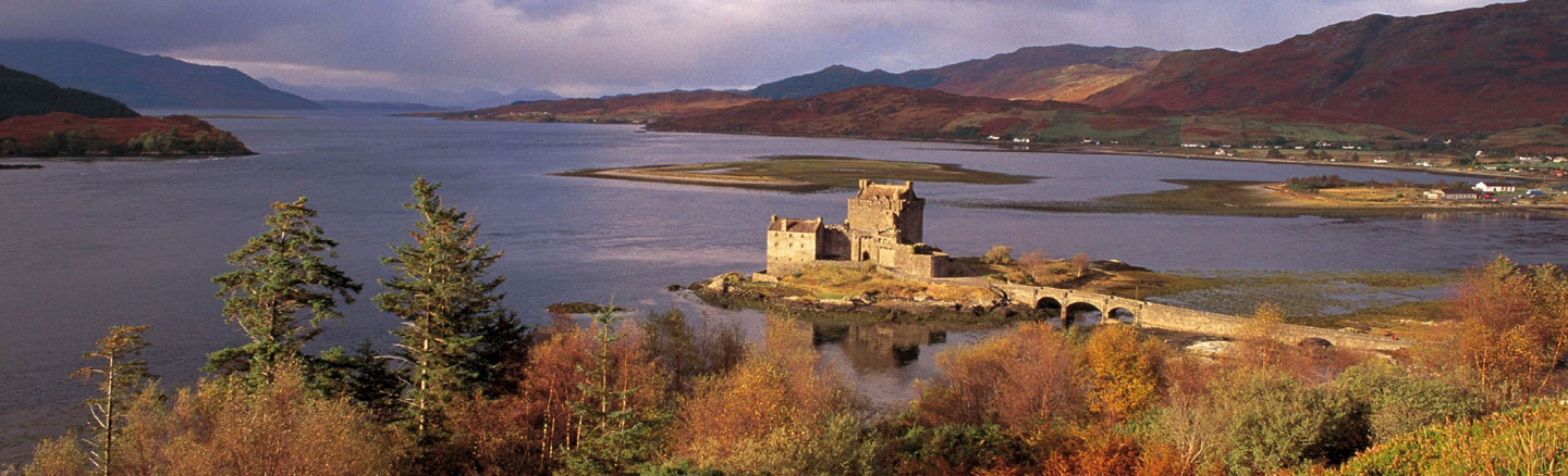 Autumnal view of Eilean Donan Castle with Loch Alsh in the background