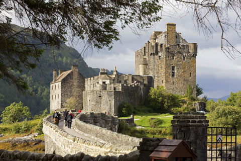 Visitors cross the bridge to reach Eilean Donan Castle