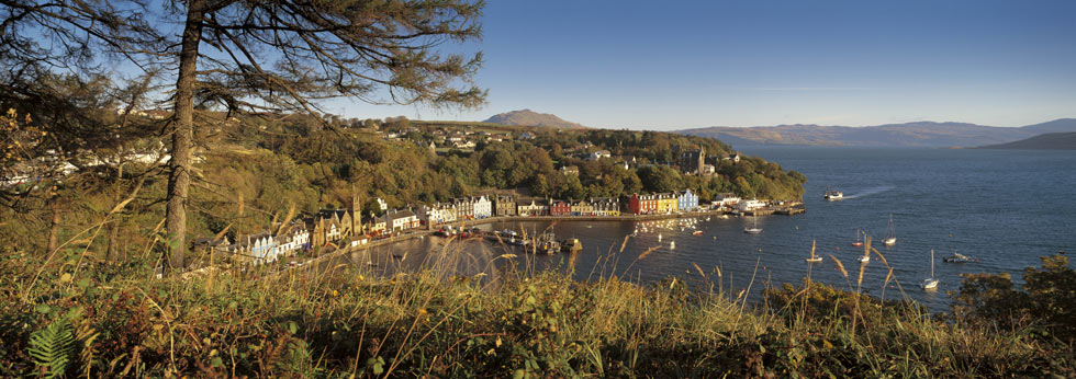 Looking out over the Sound of Mull with the colourful buildings that surround Tobermory Bay seen below