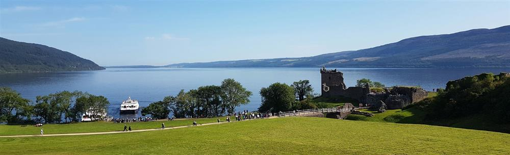 People walking along path to Urquhart Castle at Loch Ness