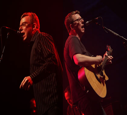 The Proclaimers Craig and Charlie Reid back to back on stage performing