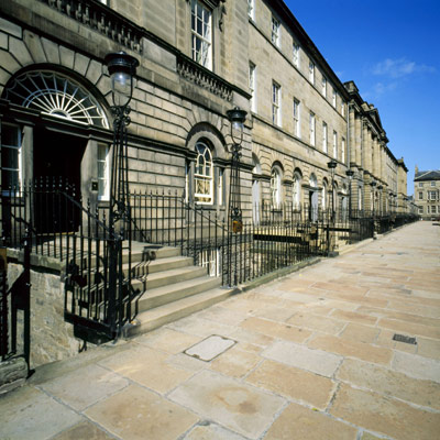 row of grand houses along a wide paved street in Edinburgh New Town