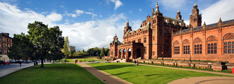 Kelvingrove Art Gallery and Museum - red sandstone building surrounded by lawns