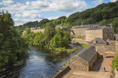 mill and millworkers cottages alongside the river at New Lanark